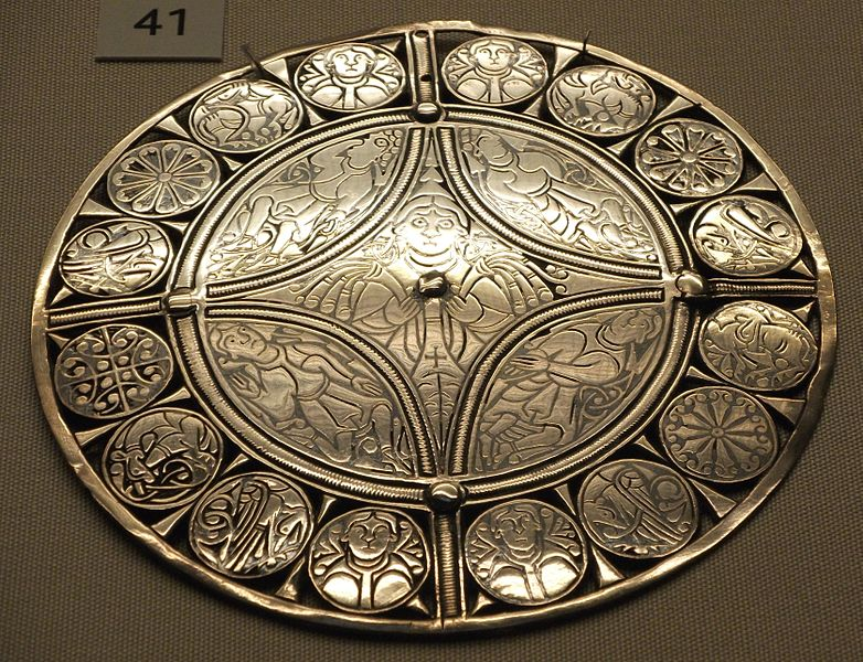 The Fuller Brooch is decorated with images of the 5 senses.
